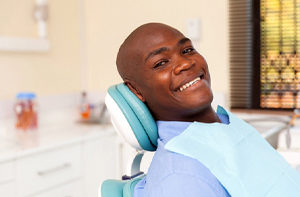 Man smiles after getting dentures in Carrolton